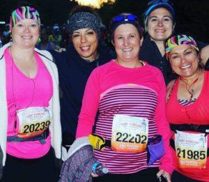 Busy working mother with friends running their first half marathon