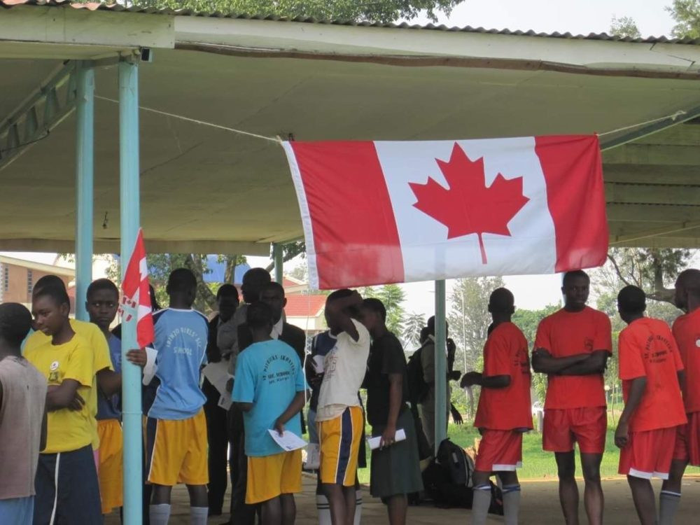 Young Kenyan Runners and Canada Flag