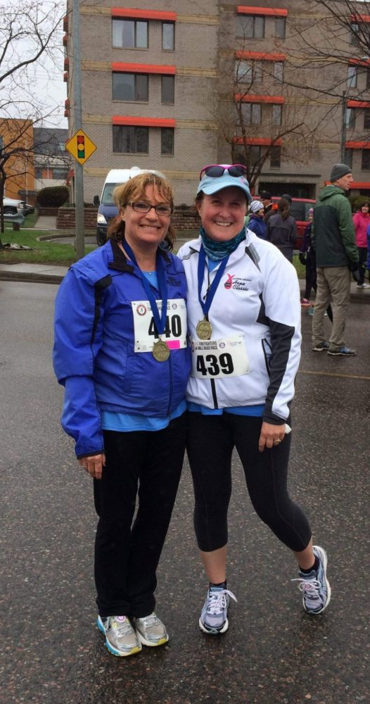 Busy working mother with friend after running first 5 kilometer race