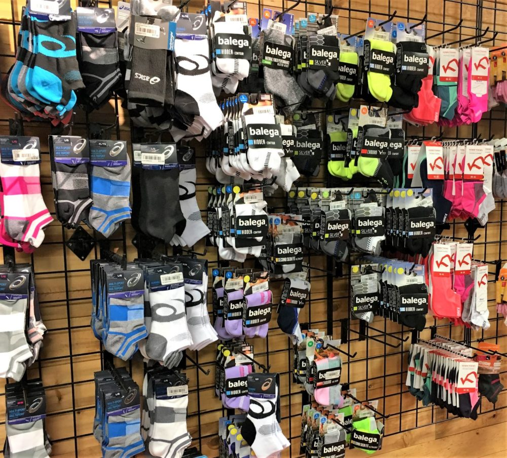 A wall of socks for running